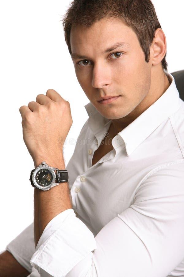 Homme d'affaires avec la montre photo libre de droits