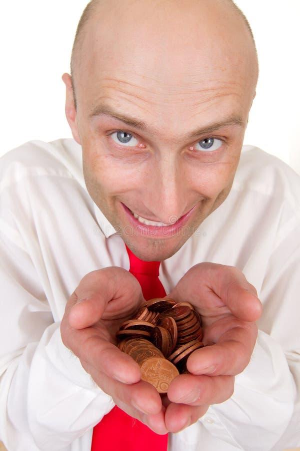 Homme d'affaires avec la pile des pièces de monnaie photos stock