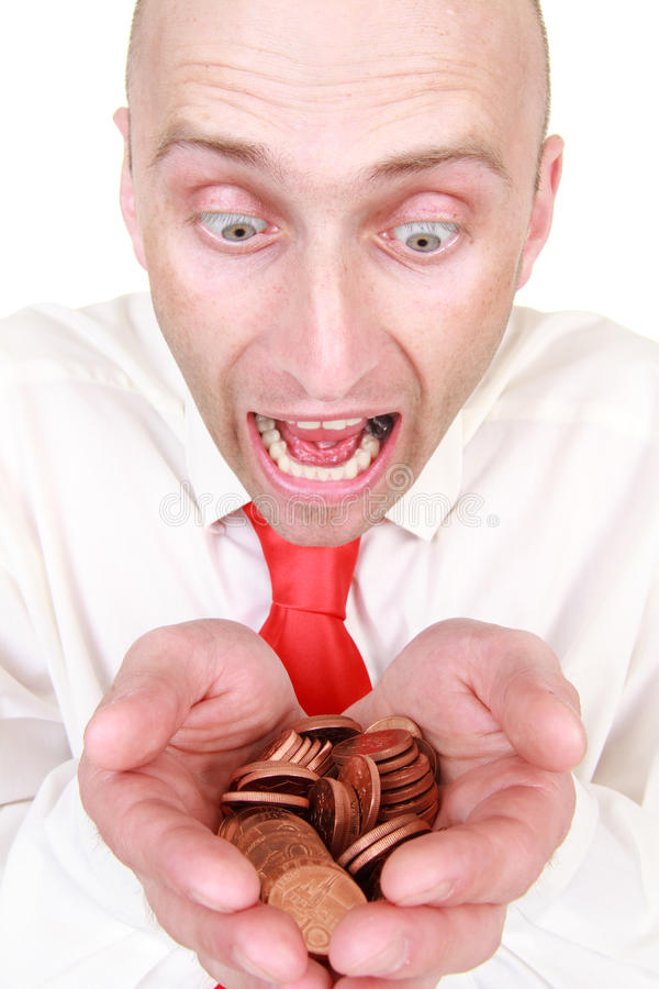 Homme d'affaires avec la pile des pièces de monnaie images libres de droits