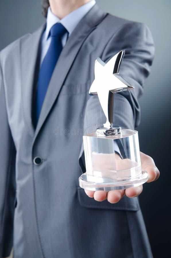 Homme D Affaires Avec La Récompense D étoile Images libres de droits