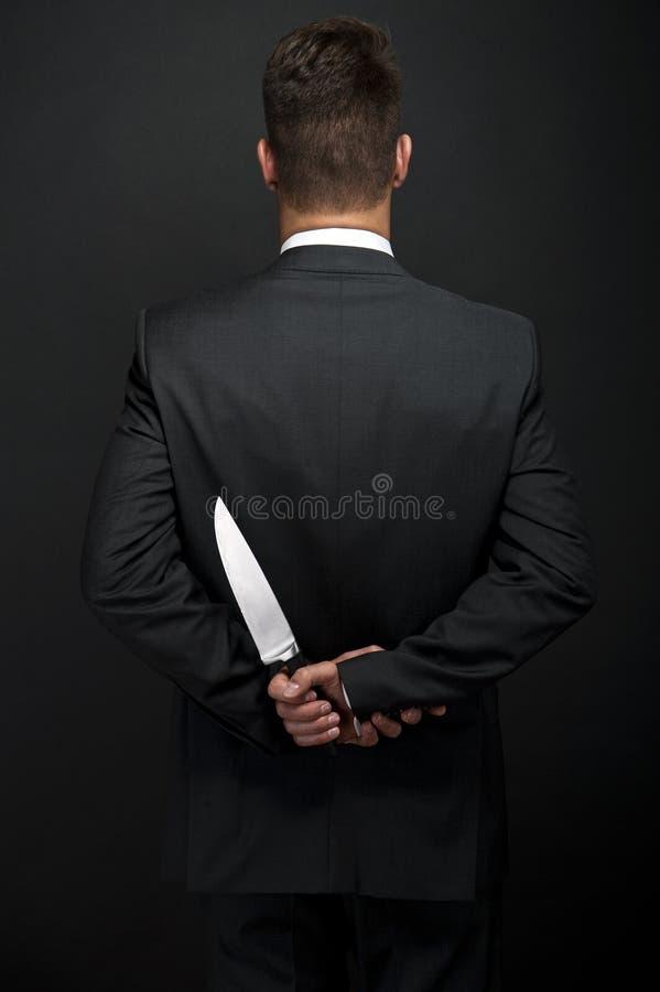 Homme d'affaires avec le couteau à disposition images libres de droits