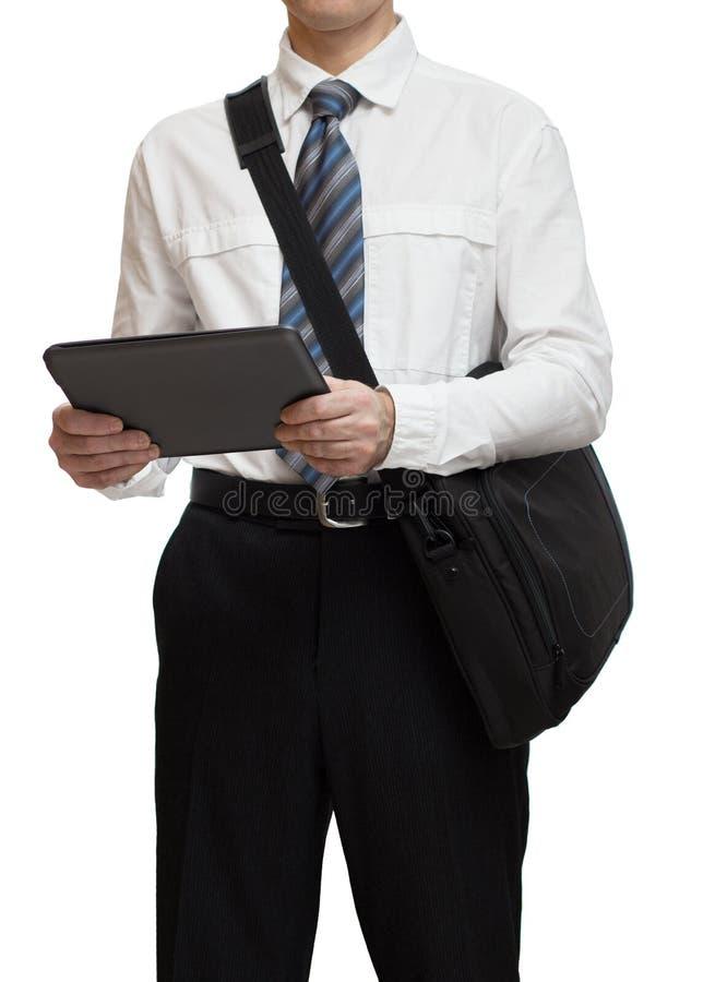 Homme d'affaires avec le lien tenant un PC de serviette et de comprimé photographie stock libre de droits