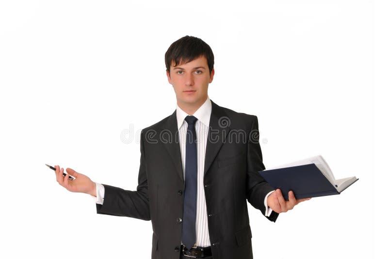 Homme d'affaires avec le livre de laiterie photographie stock libre de droits