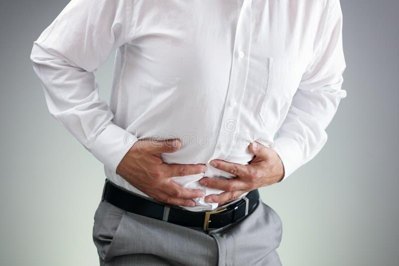 Homme d'affaires avec le mal d'estomac images stock
