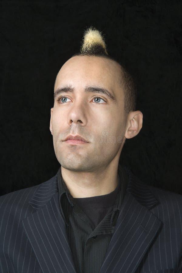Homme d'affaires avec le Mohawk. photos stock