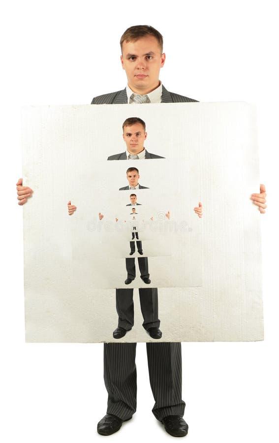 Homme d'affaires avec le panneau de plastique avec des hommes d'affaires photographie stock libre de droits