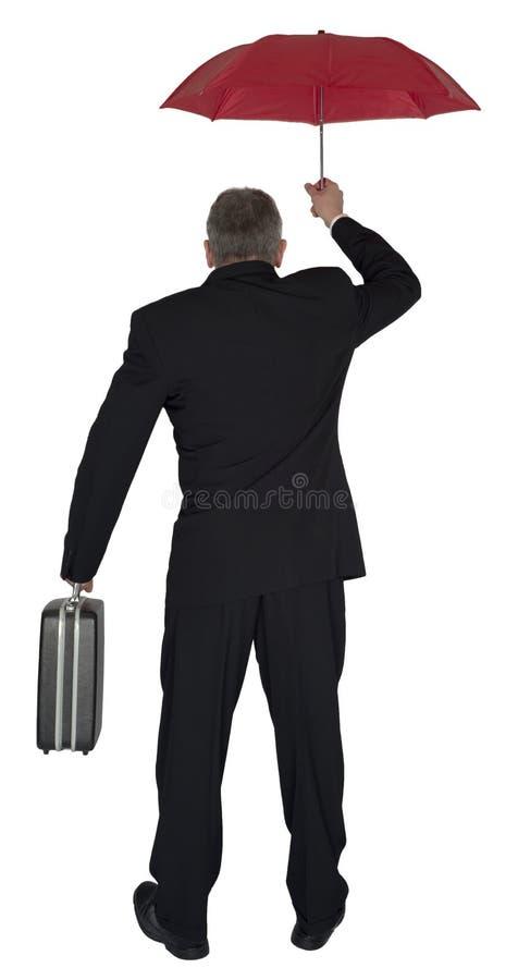 Homme d'affaires avec le parapluie rouge d'isolement photos stock