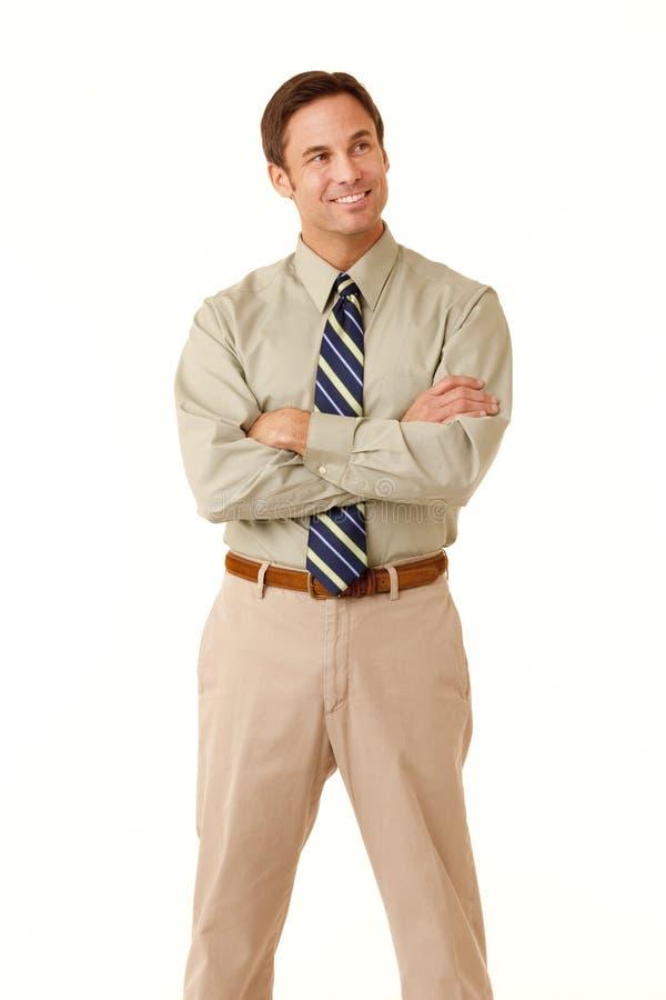 Homme d'affaires avec le regard croisé par bras hors fonction photo libre de droits