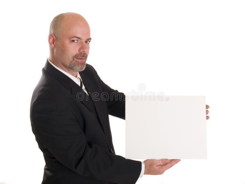 Homme d'affaires avec le signe blanc images stock