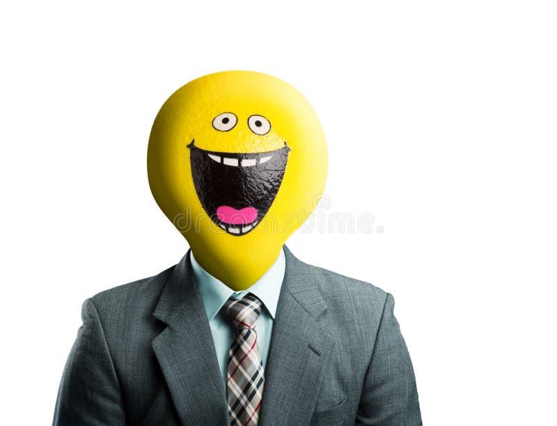 Homme d'affaires avec le visage souriant au lieu de la tête photographie stock