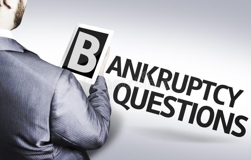 Homme d'affaires avec les questions de faillite des textes dans une image de concept images stock