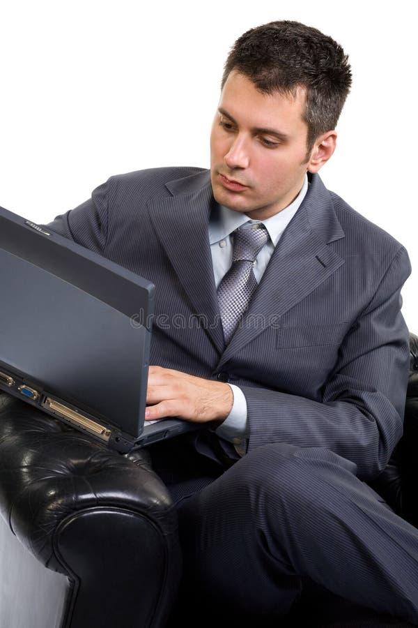 Homme d'affaires avec un ordinateur portable image libre de droits