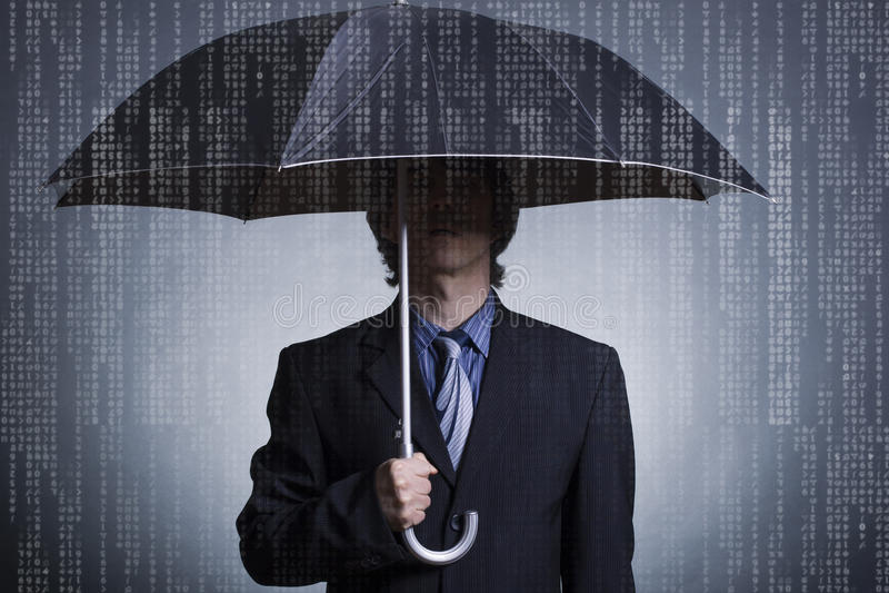 Homme d'affaires avec un parapluie image stock