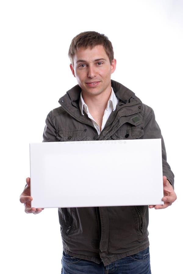 Homme d'affaires avec une carte blanche vide photographie stock