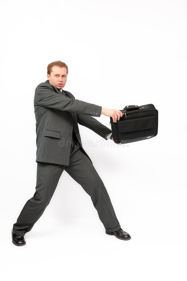 Homme d'affaires avec une serviette photo stock