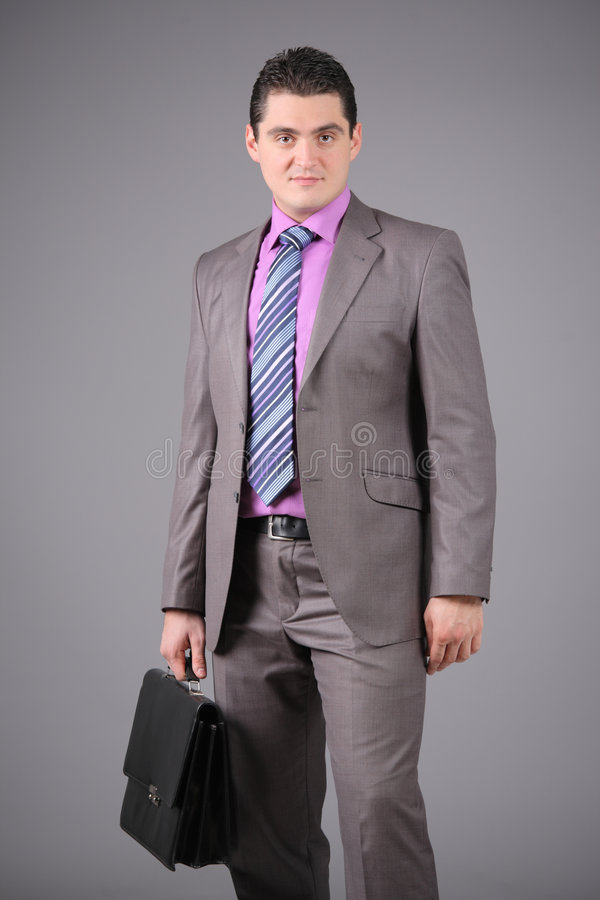 Homme d'affaires avec une serviette images stock