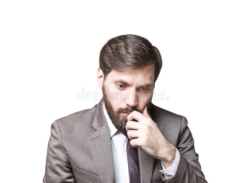 Homme d'affaires barbu dans le doute, d'isolement photos stock