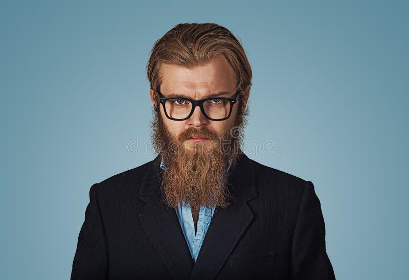 Homme d'affaires barbu sérieux Wearing Eyeglasses de hippie photo libre de droits