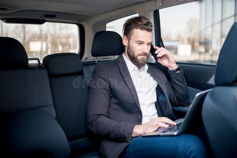 Homme d'affaires In The Car photos stock