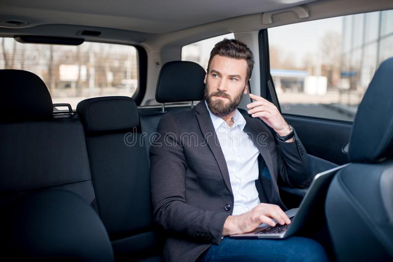 Homme d'affaires In The Car photo stock