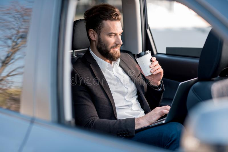 Homme d'affaires In The Car images stock
