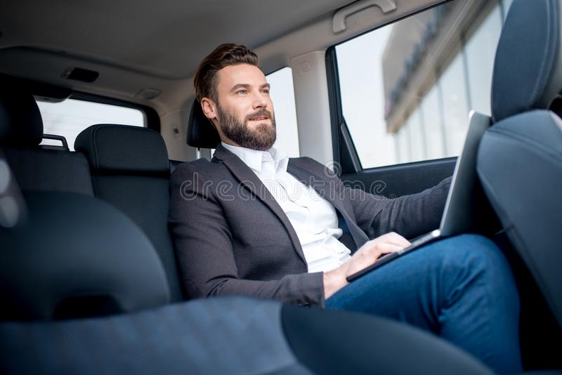 Homme d'affaires In The Car photographie stock