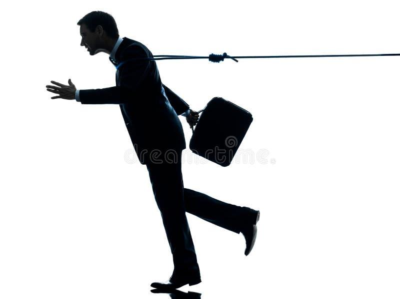 Homme d'affaires catched par la silhouette de corde de lasso images libres de droits