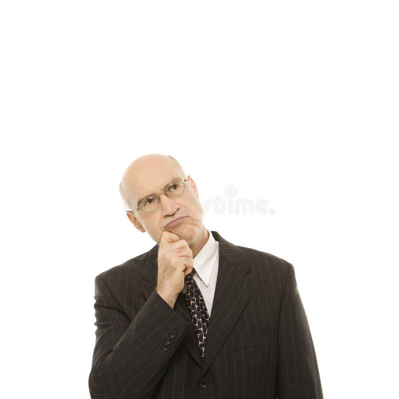 Homme d'affaires caucasien semblant pensif. image libre de droits