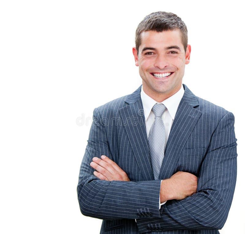 Homme d'affaires confiant avec les bras pliés photographie stock