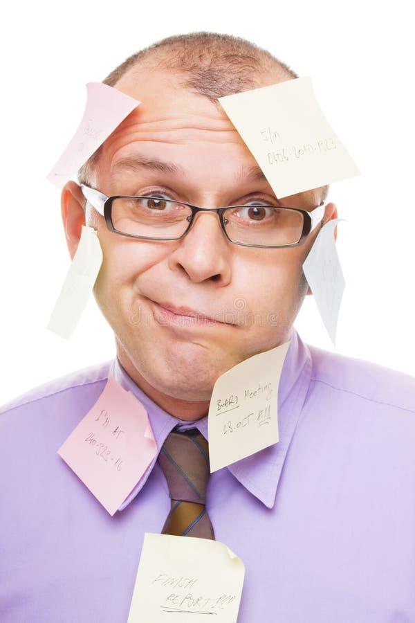 Homme d'affaires couvert de notes collantes image stock
