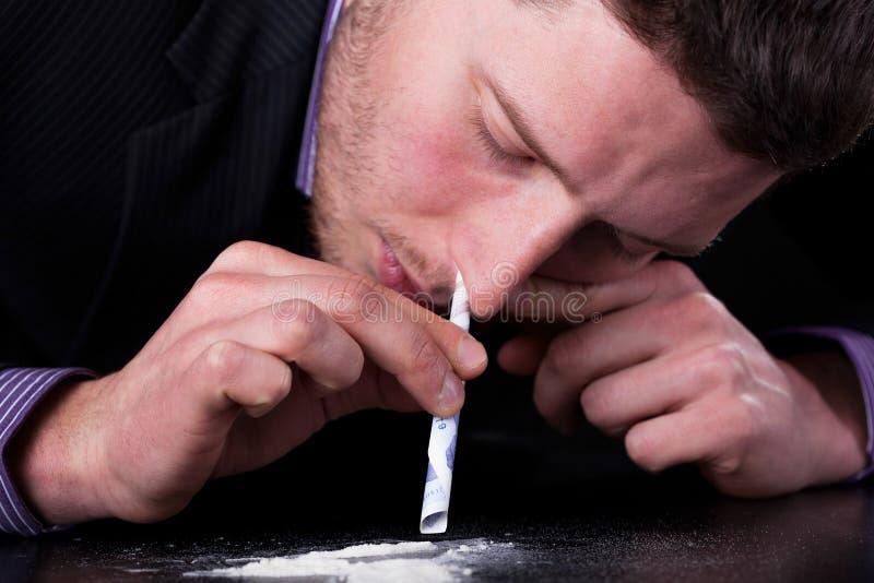 Homme d'affaires dépendant aux drogues images libres de droits