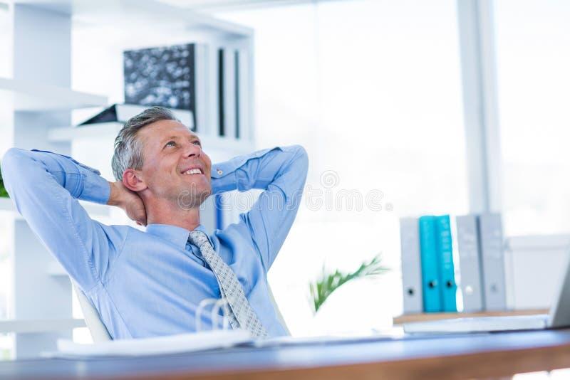 Download Homme D'affaires Détendant Dans La Chaise Pivotante Image stock - Image du procès, mâle: 56480443