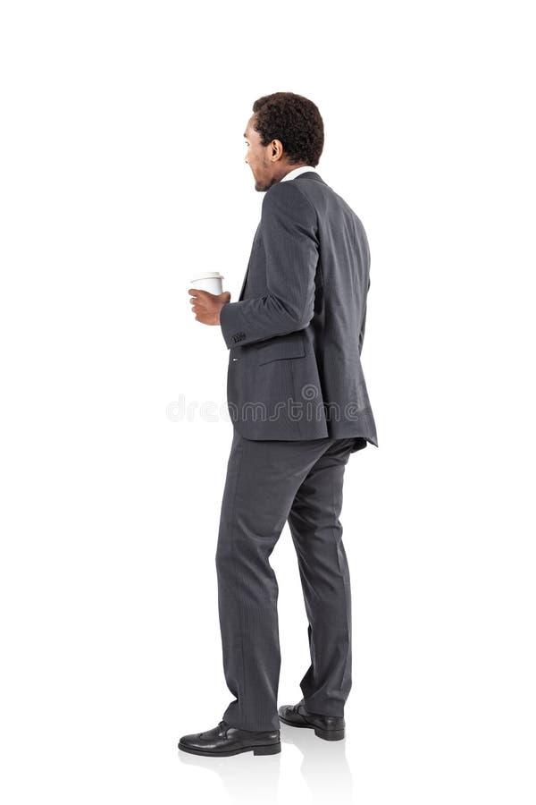 Homme d'affaires d'afro-américain avec du café d'isolement photographie stock