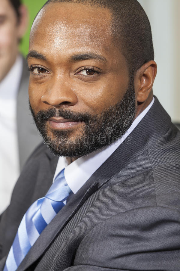 Homme d'affaires d'Afro-américain lors de la réunion image libre de droits