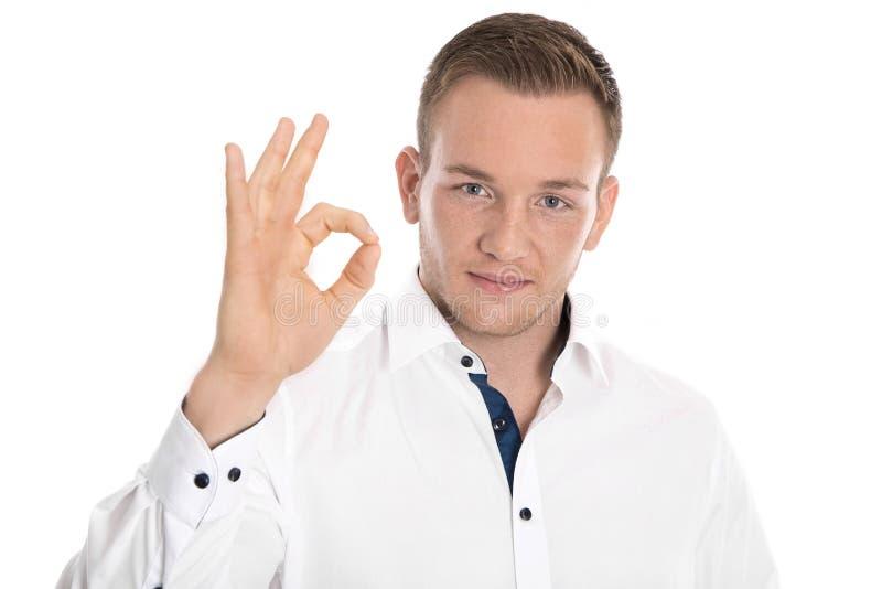 Homme d'affaires d'isolement rendant excellent, qualité ou esprit correct de geste photo libre de droits