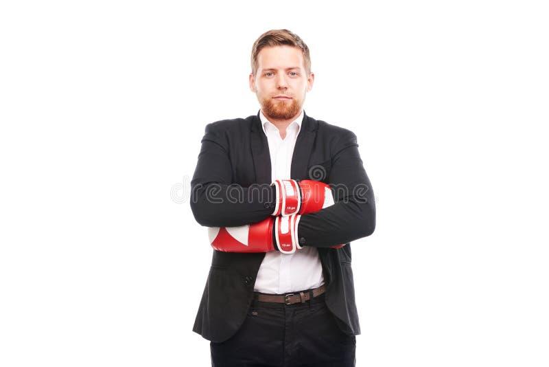 Homme d'affaires dans des gants de boxe photo stock