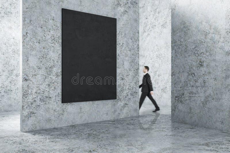 Homme d'affaires dans l'intérieur avec le cadre vide image libre de droits
