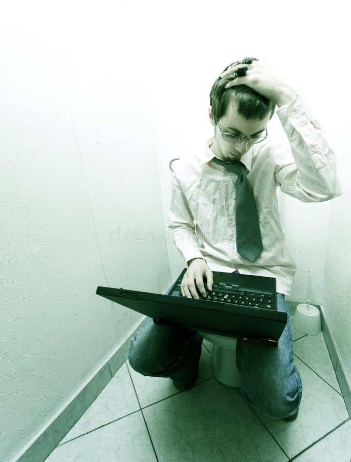 Homme d'affaires dans la toilette photos libres de droits