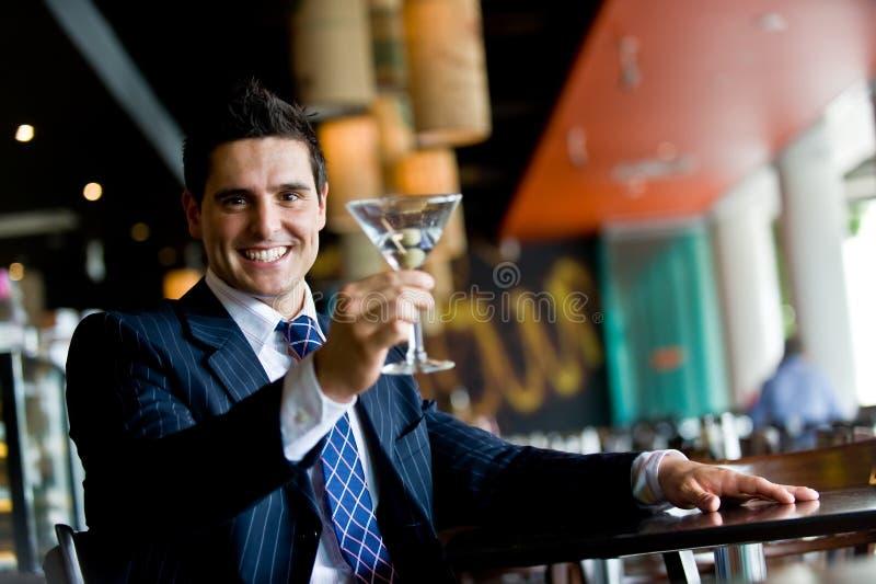 Homme d'affaires dans le bar photos stock