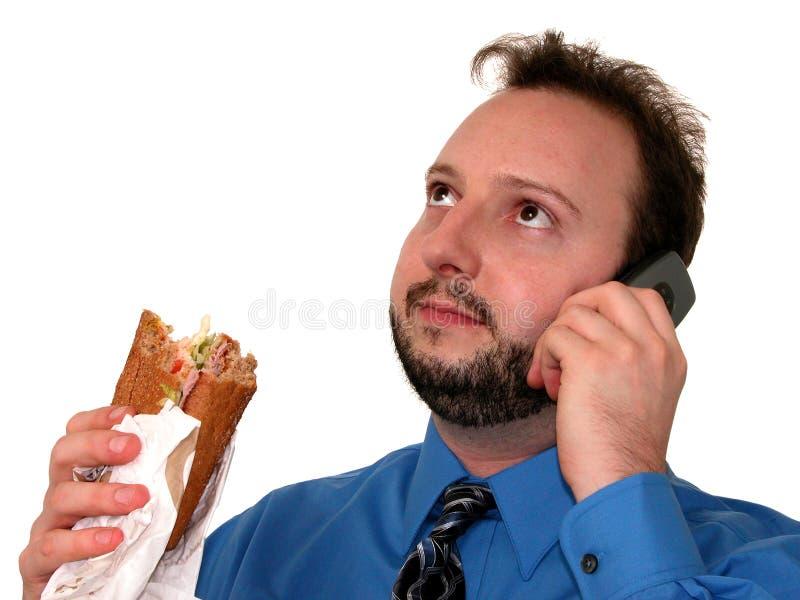 Homme d'affaires dans le bleu (mangeant le déjeuner) photo libre de droits