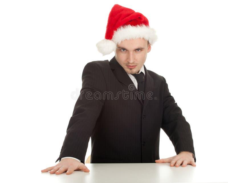 Homme d'affaires dans le chapeau rouge de Noël photo libre de droits