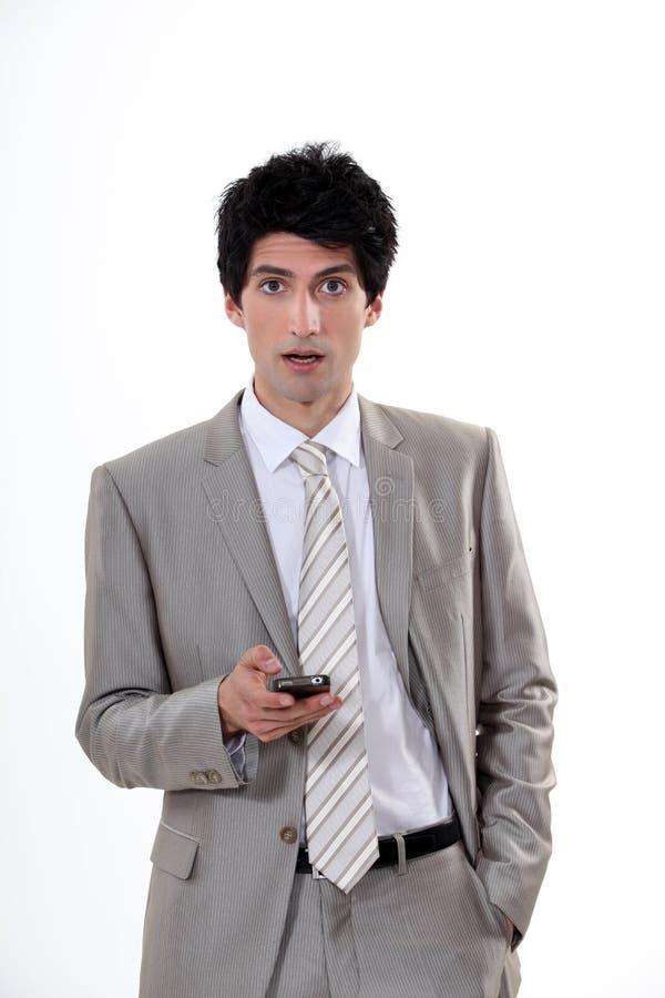 Homme d'affaires dans le choc image stock
