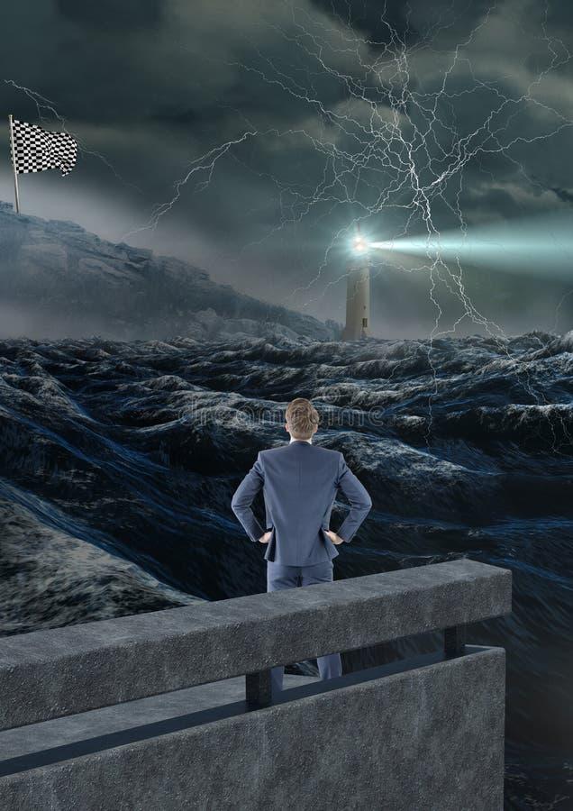 homme d'affaires dans le coin du pont avec la mer près, regardant le drapeau de contrôleur storm photographie stock