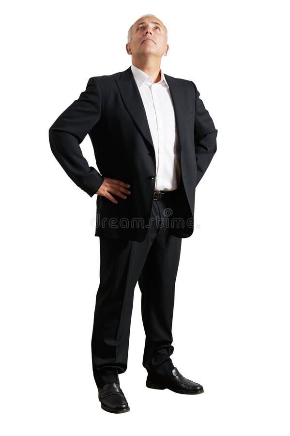 Homme d'affaires dans le costume noir recherchant photo stock
