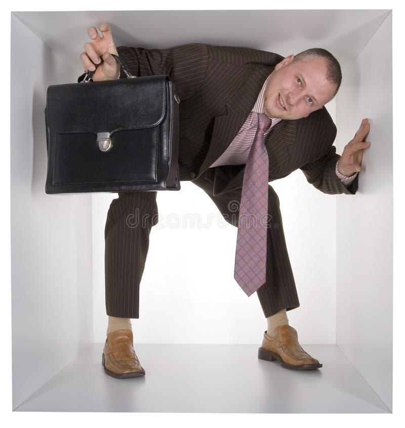 Homme d'affaires dans le cube photos stock
