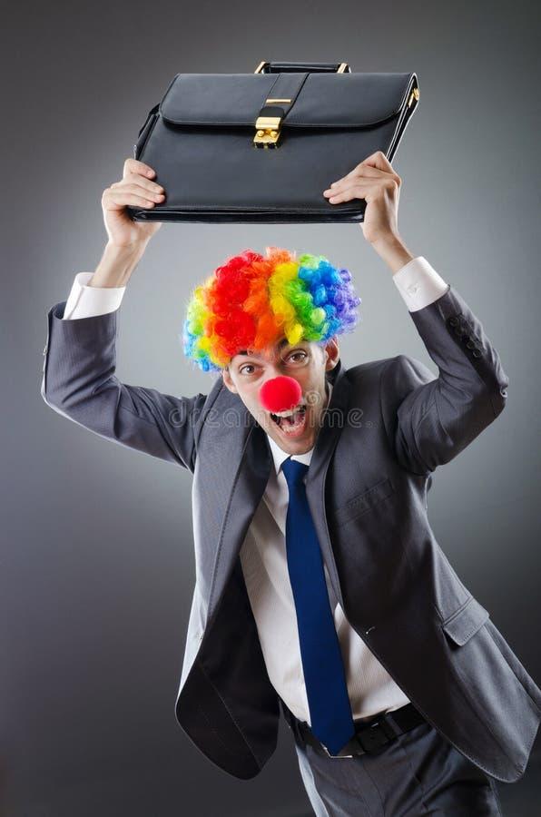 Homme d'affaires de clown - concept d'affaires drôles photographie stock libre de droits