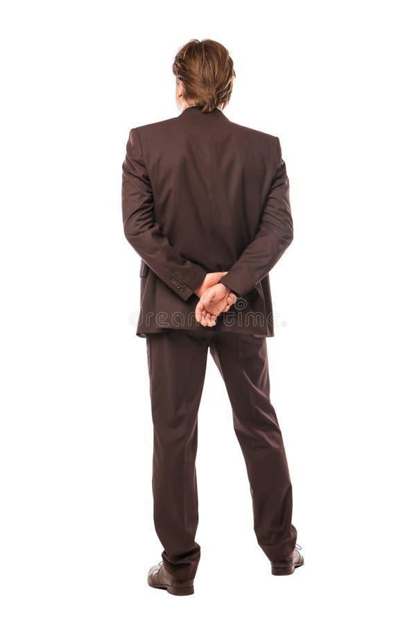 Homme d'affaires de l'arrière regardant quelque chose photo libre de droits