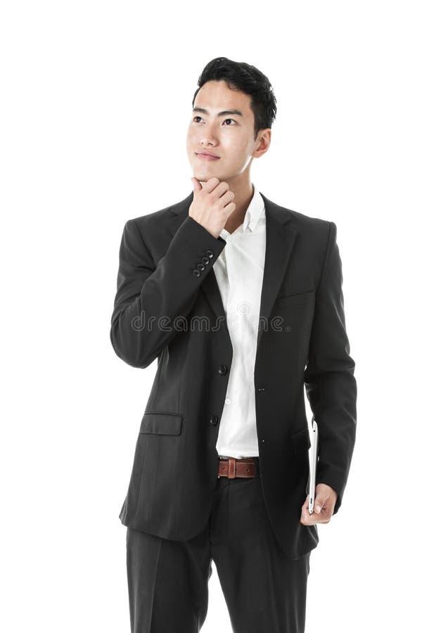 Homme d'affaires de pensée avec un comprimé images stock
