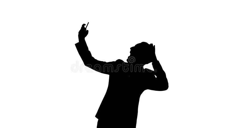 Homme d'affaires de silhouette prenant un selfie illustration libre de droits