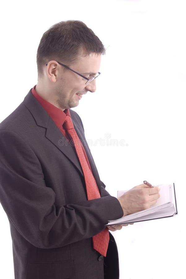 Homme d'affaires de Similing avec l'ordre du jour image libre de droits